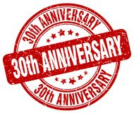 30th anniversary red stamp. 30th anniversary red grunge round stamp isolated on white background Stock Image