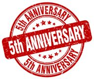 5th anniversary red stamp. 5th anniversary red grunge round stamp isolated on white background vector illustration