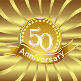 50th anniversary ribbon logo with golden rays of light. Stock Photography