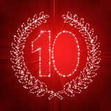 10th anniversary. With stars and red rays Stock Photos
