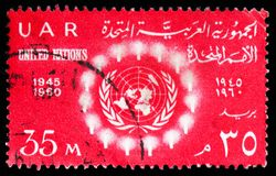 15th Anniversary UNO - Light surrounding UN emblem, United Nations Organisation serie, circa 1960. MOSCOW, RUSSIA - FEBRUARY 10, 2019: A stamp printed in Egypt stock photography