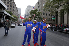 70th annual Columbus Day Parade in NYC. Harlem Globetrotters pause by Rockefeller Center on Fifth Avenue Stock Photos