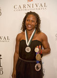 29th Annual Great Sports Legends Dinner. United States summer and winter medalist Lauryn Williams arrives on the red carpet for the 29th Annual Great Sports Stock Images