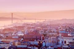 25th of April Bridge in Lisbon. 25th of April Bridge and city panorama of Lisbon . Lisbon, Portugal Stock Photography