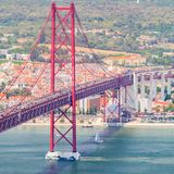 25th of April Bridge in Lisbon. Panorama. 25th of April Bridge in Lisbon. Panoramic view of Lisbon, the Tagus River and Bridge from the National Sanctuary of Stock Photos