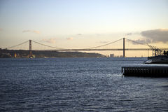 25th of April Bridge at sunset in Lisbon, Portugal Stock Photos