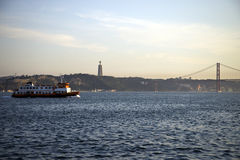 25th of April Bridge at sunset in Lisbon, Portugal Stock Images