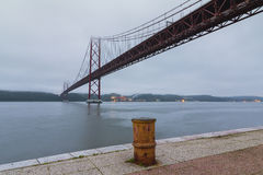 The 25th of April (25 de Abril) suspension bridge over Tagus river in Lisbon Royalty Free Stock Images