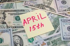 Th april för text 15 med dollaren Arkivbild