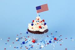 4th av den Juli muffin med flaggan, stänk Royaltyfria Bilder