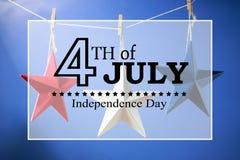 4th av Juli garneringar på blå bakgrund Royaltyfri Bild