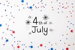 4th av Juli garneringar på en vit bakgrund Royaltyfria Bilder