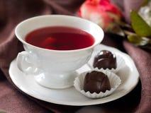 Thé avec la sucrerie Photographie stock libre de droits