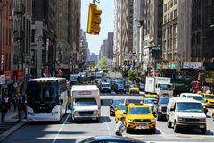 8th Avenue in Manhattan. New York City, USA - May 19, 2014: Many cars driving and waiting on the 8th Avenue in midtown manhattan Stock Image