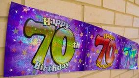 70th bandeira feliz do aniversário na parede Fotografia de Stock