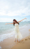 On th beach. Beautiful lady happy on the beach Royalty Free Stock Photo