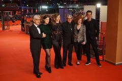The 68th Berlinale jury members during the closing ceremony. Berlin, Germany - February 24, 2018: The 68th Berlinale jury members Ryuichi Sakamoto, Adele stock photography