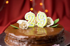 29th birthday cake decorated with edible roses. 29th birthday cake decorated with edible white roses Stock Photos
