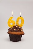 60th birthday muffin cake with candles Stock Photo