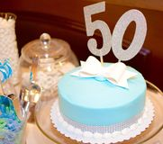 Fancy 50th Birthday Cake. A 50thbirthday cake in Tiffany Blue royalty free stock image