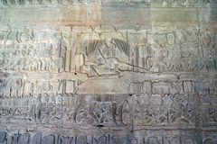 12th century Angkor Wat temple bas relief - Yama, eighteen-armed ruler of Hell, rides a buffalo while judging the newly dead. stock image