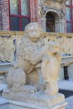 14th century Artus Court on Long Market street, Gdansk, Poland. 14th century Artus Court on Long Market street, the sculpture of a stone lion in front of the Royalty Free Stock Image