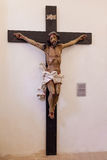 18th century Baroque Crucifix in natural size in the museum of the Misericordia Church. Stock Photos
