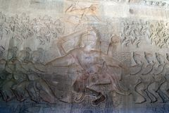 12th century bas relief  hindu story of creation - Vishnu at the centre of The Churning of the Sea of Milk. Scene around the Angkor Archaeological Park. The site Royalty Free Stock Image