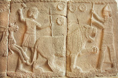 8th century BC bas-relief with great scene with tiger hunters Royalty Free Stock Images