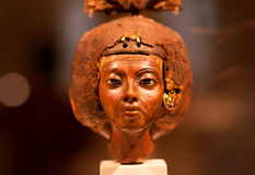 14th century BC statuette of queen Tiy with feather crown in Egyptian Museum Royalty Free Stock Image