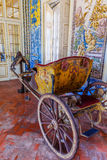 18th century carriage in the Mangas or Tiles Corridor. Stock Images