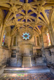 13th century chapel. The 13th century chapel that is inside the ruin priory at Tynemouth. The chapel has beautiful stained glass windows. The images is HDR Royalty Free Stock Photo