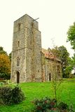 11th Century Church. St Mary's church at Houghton-on-the-hill in Norfolk.  The church dates from the 11th century. It has been restored over the last 25 years Stock Images