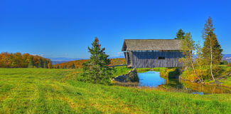 19th Century covered bridge in rural Vermont HDR. Stock Photography
