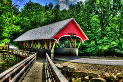 19th Century covered bridge with a wooden walk along side of it HDR. Royalty Free Stock Image