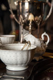 18th Century cups and saucers crockery on inlaid wooden serving Royalty Free Stock Images