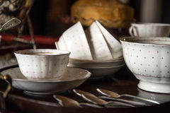 18th Century cups and saucers crockery on inlaid wooden serving Royalty Free Stock Photography