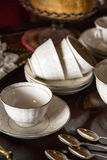 18th Century cups and saucers crockery on inlaid wooden serving Royalty Free Stock Image