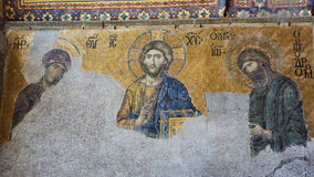 13th century Deesis Mosaic of Jesus Christ flanked by the Virgin Mary and John the Baptist in the Hagia Sophia temple in Stock Photo