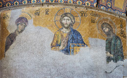13th century Deesis Mosaic of Jesus Christ flanked by the Virgin Mary and John the Baptist in the Hagia Sophia temple in. 13th century Deesis Mosaic of Jesus Royalty Free Stock Images
