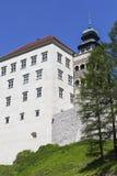 14th century defense Castle Pieskowa Skala ,near Krakow, Poland. 14th century defense Castle Pieskowa Skala , clock tower, near Krakow, Poland. Located in Stock Photography
