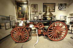 Firefighting in New York by The New York City Fire Museum. 18th Century Fire Trucks. The New York City Fire Museum houses one of the nation's most important Royalty Free Stock Image