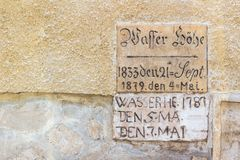 18th and 19th century flood height level markers on old wall. In Sopron, Hungary. Caption says: Wasser höhe = Water height royalty free stock image