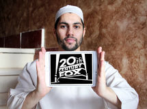 20th century fox logo. Logo of the american 20th century fox on samsung tablet holded by arab muslim man Stock Images