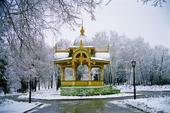 19th Century Historical Monument of Architecture Elegant and Int. Ricate Carved Wood Gazebo Altanka which is a Symbol of the City of Sumy in Ukraine on a Frosty Stock Photography