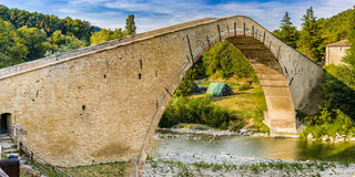 16th century humpbacked bridge. 16th century engineering masterpiece humpbacked bridge connecting in a single span the two banks of Santerno river in Emilia royalty free stock photos