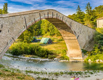 16th century humpbacked bridge. 16th century engineering masterpiece humpbacked bridge connecting in a single span the two banks of Santerno river in Emilia royalty free stock image