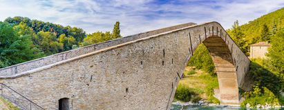 16th century humpbacked bridge. 16th century engineering masterpiece humpbacked bridge connecting in a single span the two banks of Santerno river in Emilia royalty free stock photo