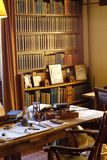 19th century office of an author with desk and bookshelf stock photography