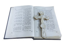 19th Century old bible and cross isolated over white Royalty Free Stock Photo